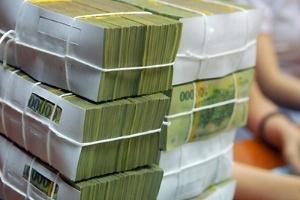 Nhiều ngân hàng huy động vốn vượt trần