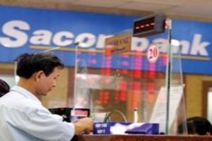 STB chưa giải chấp hết cổ phiếu của cha con ông Đặng Văn Thành