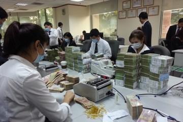Đánh thuế tiền gửi ngân hàng: Doanh nghiệp chịu thuế hai lần?