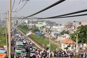 TPHCM: Người dân kiếm tiền triệu mỗi ngày nhờ kẹt xe