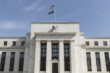 Fed kết thúc QE3, nhưng tiếp tục cam kết giữ lãi suất ở mức thấp