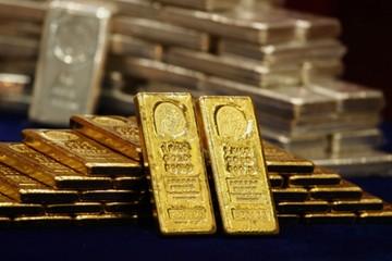 Quỹ đầu tư ồ ạt bán vàng