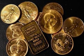 Quỹ ETF và đồng USD kéo giá vàng khỏi đáy