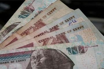 Ai Cập phá giá đồng tiền gần 50%