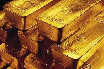 Vàng đạt đỉnh 3 tháng lên gần 1.240 USD/oz