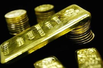 Vàng giảm khi triển vọng lãi suất Mỹ tăng nâng giá đồng USD