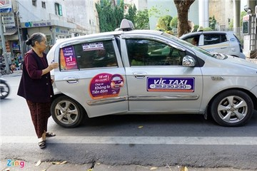 Các hãng taxi Hà Nội nói gì về quy định xe 'mặc đồng phục'?