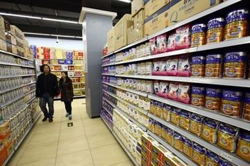 Thất thế trong nước, sữa bột Trung Quốc tìm cách xuất ngoại
