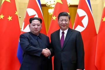 Hé lộ hình ảnh Kim Jong-un bí mật gặp Chủ tịch Trung Quốc