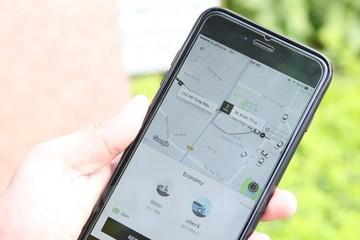 'Grab, Uber như... con cá mập tấn công, thôn tính thị trường taxi'