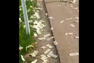 Mưa tiền trên sa lộ Mỹ, 600.000 USD tung bay trong gió