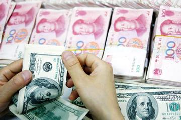 Trung Quốc toan tính gì khi hạ giá nhân dân tệ