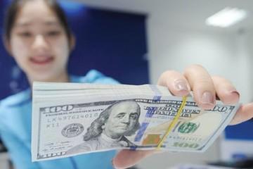 Tỷ giá tại Vietcombank lần đầu tăng lên 23.395 đồng/USD