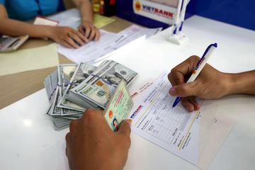 Cho người nước ngoài đặt cọc, ký quỹ mua cổ phần bằng ngoại tệ ?