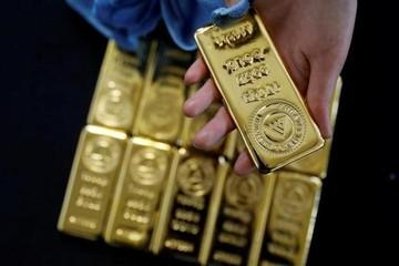 USD tăng giá, vàng giảm về gần mốc 1.300 USD