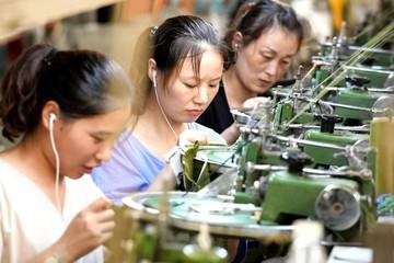Kinh tế Trung Quốc giảm tốc, sản lượng công nghiệp tăng chậm nhất 17 năm