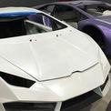 <p> Những chiếc Ferrari và Lamborghini nhái này được rao bán trên mạng xã hội với giá 45.000 – 60.000 USD. Trong khi đó, theo trang motor1.com, một chiếc Ferrari thật có giá khởi điểm vào khoảng 215.000 USD. Ảnh: <em>AP</em>.</p>
