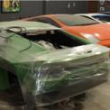 <p> Tại hiện trường của vụ bắt giữ này, cảnh sát tìm thấy 8 chiếc Ferrari và Lamborghini đang được lắp ráp. Ảnh: <em>AP</em>.</p>