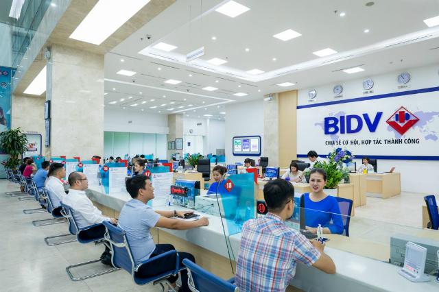 Lãi sau thuế ngân hàng mẹ BIDV giảm 7% trong quý II. Ảnh: BIDV.