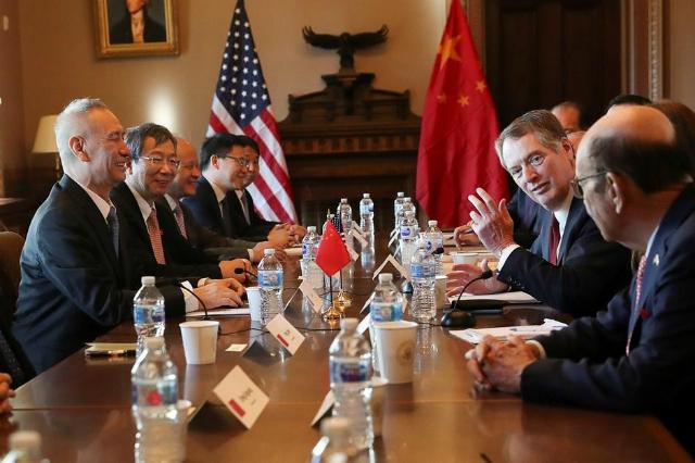 Đàm phán thương mại Mỹ - Trung được nối lại từ sau cuộc gặp Trump - Tập hồi cuối tháng 6. Ảnh: Reuters.