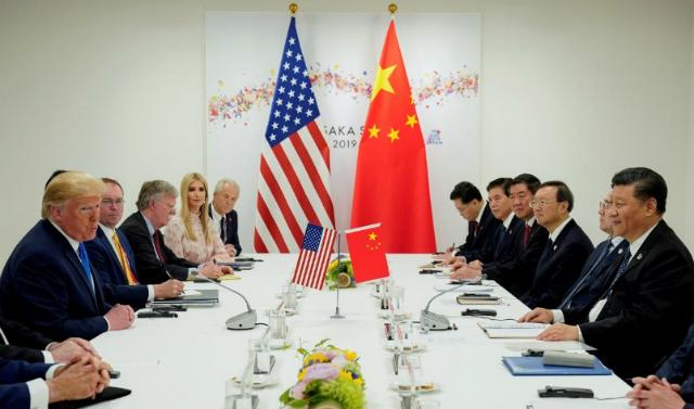 Tổng thống Mỹ Donald Trump và Chủ tịch Trung Quốc Tập Cận Bình trong cuộc gặp hồi cuối tháng 6 tại Nhật Bản. Ảnh: Reuté.