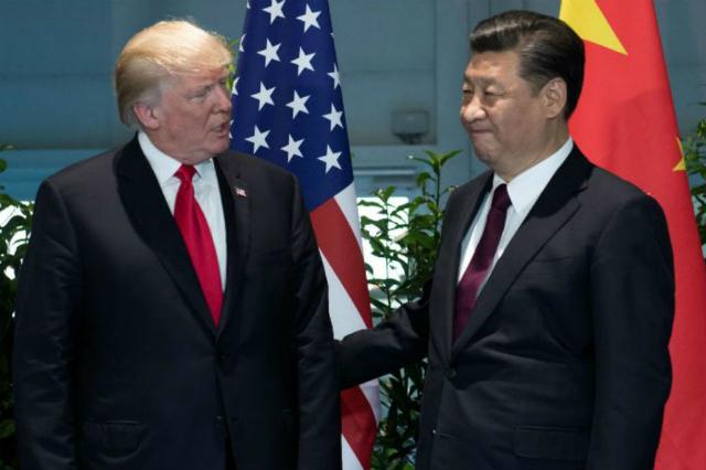 Tổng thống Mỹ Donald Trump (trái) và Chủ tịch Trung Quốc Tập Cận Bình. Ảnh: ABS CBN.