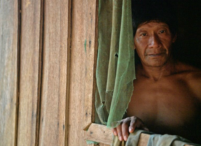 A member of Uru Eu Wau Wau tribe poses in the tribe's reserve in the Amazon, south of Porto Velho, Brazil, on August 29, 2019