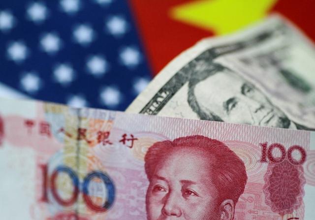 Nhân dân tệ mất giá mạnh trong tháng 8, CNY/USD vượt ngưỡng tâm lý 7. Ảnh: Reuters.