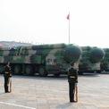 <p> Đây cũng là dịp để Trung Quốc phô trương các vũ khí của mình, qua đó khẳng định sức mạnh quân sự với thế giới. Đây là các bệ phóng mang tên lửa đạn đạo xuyên lục địa DF-41. Ảnh: <em>Reuters.</em></p>