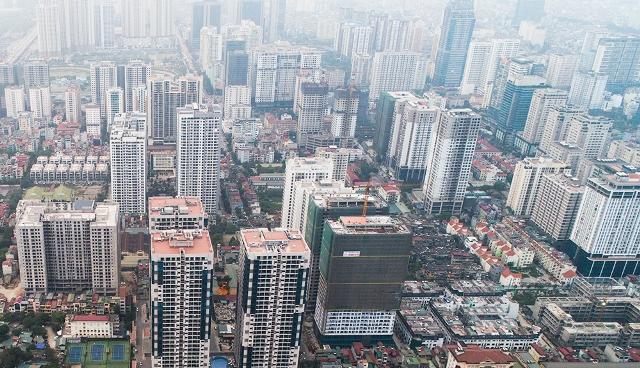 Nhà cao tầng đua nhau thế chỗ nhà máy, trường học di dời ở Hà Nội - Ảnh 1.