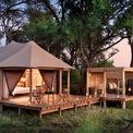 """<p class=""""Normal""""> <strong>10. andBeyond Nxabega Okavango Tented Camp</strong></p> <p class=""""Normal""""> Địa điểm: Okavango Delta, Botswana</p> <p class=""""Normal""""> Giá khởi điểm/đêm: 835 USD</p> <p class=""""Normal""""> Nxabega Okavango Tents Camp có 9 lều, mỗi lều đều có hiên và vòi hoa sen ngoài trời. (Ảnh: <em>andBeyond</em>)</p>"""