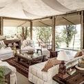 """<p class=""""Normal""""> <strong>6. Richard's River Camp</strong></p> <p class=""""Normal""""> Địa điểm: Khu bảo tồn quốc gia Masai Mara, Kenya</p> <p class=""""Normal""""> Giá khởi điểm/đêm: Chỉ thông báo giá khi được yêu cầu</p> <p class=""""Normal""""> Khu nghỉ dưỡng do một cặp vợ chồng thành lập năm 2006 với 7 lều có sức chứa 16 người cùng lúc. Cặp vợ chồng đã trang trí resort của họ bằng những nguyên liệu thu thập được qua các chuyến đi du lịch. Resort cung cấp cả dịch vụ bay khinh khí cầu. (Ảnh: <em>Richard's Camp</em>)</p>"""