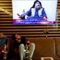 """<p class=""""Normal""""> Người dân tại Najaf, Iraq ngồi xem bản tin cho biết thủ lĩnh Nhà nước Hồi giáo tự xưng (IS) Abu Bakr al-Baghdadi đã bị tiêu diệt vào ngày 27/10. Cùng ngày, Tổng thống Mỹ Donald Trump xác nhận thông tin Abu Bakr al-Baghdadi đã thiệt mạng trong chiến dịch của quân đội Mỹ tại Syria. """"Đêm qua, Mỹ đã đưa kẻ khủng bố số một thế giới ra trước công lý. Ông ta đã chết như một con chó, chết như một kẻ hèn hạ. Thế giới giờ đây là một nơi an toàn hơn rất nhiều"""", ông Trump nói.<br /><br /><span>Sau đó, các nguồn tin an ninh từ giới chức Iran, Iraq và Syria tiếp tục xác nhận thông tin trên. Đến ngày 30/10, người phát ngôn của IS xác nhận cái chết của Baghdadi, công bố thủ lĩnh mới là Abi Ibrahim al-Hashimi al-Qurashi và kêu gọi các tay súng trả thù. Ảnh: </span><em>Reuters</em><span>.</span></p>"""