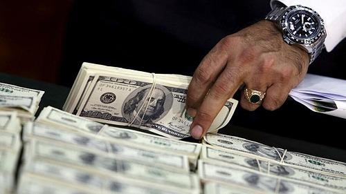 Ít cơ hội đầu tư hấp dẫn khiến lượng lớn tiền mặt của các gia đình siêu giàu đang nhàn rỗi. Ảnh minh hoạ: Reuters