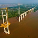 """<p class=""""Normal""""> Công trình có vốn đầu tư xây dựng hơn 4,69 tỷ yen Nhật và<span style=""""color:rgb(34,34,34);"""">3.017 tỷ đồng</span><span>. Theo kế hoạch, công trình bắt đầu thi công vào tháng 8/2015 và hoàn thành sau 47 tháng. Tuy nhiên, do vướng mắc một số vấn đề về giải ngân, cây cầu hiện tạm dừng thi công.</span></p>"""