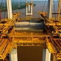 """<p class=""""Normal""""> Chiều dài nhịp chính của cây cầu này tương ứng là 375 m và 300 m. Theo ông Nguyễn Kim Cương, Chỉ huy trưởng thi công gói thầu J1, cầu dây văng Bình Khánh có trụ cầu cao 150 m - cao nhất Việt Nam khi hoàn thành.</p>"""