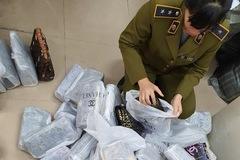 Phát hiện gần 700 túi xách 'nhái' LV, Chanel, Gucci tại Hà Nội