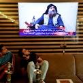 """<p class=""""Normal""""> Người dân tại Najaf, Iraq ngồi xem bản tin cho biết thủ lĩnh Nhà nước Hồi giáo tự xưng (IS) Abu Bakr al-Baghdadi đã bị tiêu diệt vào ngày 27/10. Cùng ngày, Tổng thống Mỹ Donald Trump xác nhận thông tin Abu Bakr al-Baghdadi đã thiệt mạng trong chiến dịch của quân đội Mỹ tại Syria.</p> <p class=""""Normal""""> """"Đêm qua, Mỹ đã đưa kẻ khủng bố số một thế giới ra trước công lý. Ông ta đã chết như một con chó, chết như một kẻ hèn hạ. Thế giới giờ đây là một nơi an toàn hơn rất nhiều"""", ông Trump nói.<br /><br /><span>Sau đó, các nguồn tin an ninh từ giới chức Iran, Iraq và Syria tiếp tục xác nhận thông tin trên. Đến ngày 30/10, người phát ngôn của IS xác nhận cái chết của Baghdadi, công bố thủ lĩnh mới là Abi Ibrahim al-Hashimi al-Qurashi và kêu gọi các tay súng trả thù. Ảnh: <em>Reuters</em>.</span></p>"""