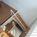 <p> Các tấm lưới được kéo thông suốt từ tầng 1 đến tầng mái, vừa tạo ra một khối không gian thống nhất, vừa tiết kiệm diện tích và tạo hiệu ứng thẩm mỹ.</p>