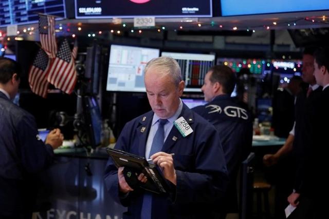 S&P 500 kết thúc đợt tăng liên tiếp 5 ngày khi chốt phiên 18/12. Ảnh: Reuters.