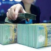 Ngân hàng Nhà nước giảm phí rút tiền mặt