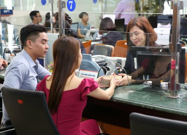 Thanh khoản ngân hàng ổn định dù vào mùa cao điểm chi trả tiền cho doanh nghiệp Ảnh: Ngọc Thắng