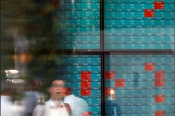Cổ phiếu ôtô giảm, chứng khoán châu Á dứt đà tăng