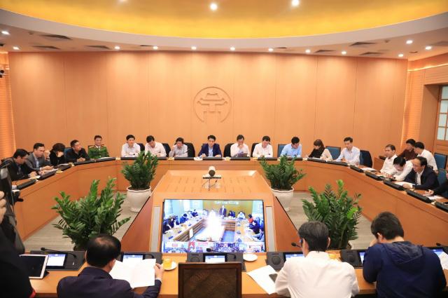 Hà Nội họp khẩn trong bối cảnh số ca nhiễm ở Hàn Quốc tăng cao trong ngày 23/2. Ảnh: T.T.