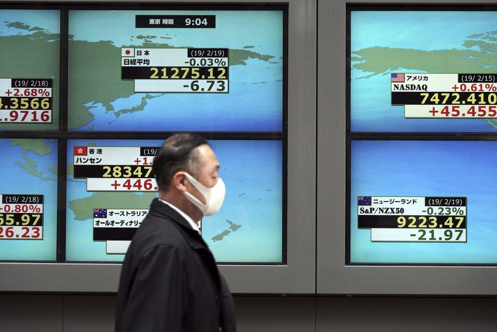 Chứng khoán châu Á trái chiều, thận trọng chờ gói kích thích 2.000 tỷ USD của Mỹ