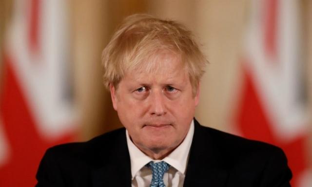 Thủ tướng AnhBoris Johnson tại cuộc họp báo ở London ngày 16/3. Ảnh: AFP.