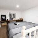 <p> Không gian gác lửng đã được cải tạo lại làm phòng ngủ với những đồ dùng đơn giản, tông màu xám trắng mang đến cảm giác rộng rãi và thoải mái.</p>