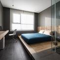 <p> Anh Nguyễn Thái Thạch cho biết đã thiết kế căn hộ trên tinh thần tối đa hóa công năng và giá trị sử dụng, tối thiểu hóa về hình thức và ngôn ngữ. Căn hộ có 3 mảng màu cơ bản: trắng, xám, gỗ và 3 vật liệu chính là gỗ, gạch đá, kim loại.</p>