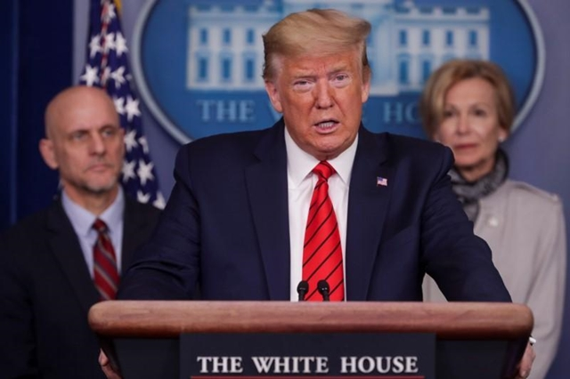 Tổng thống Donald Trump ngày 18/4 cảnh báo Trung Quốc có thể gánh hậu quả vì Covid-19. Ảnh: Reuters.