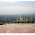 """<p class=""""Normal""""> <strong>Sau: </strong>Lưu lượng giao thông giảm do lệnh phong tỏa, thành phố dần hiện ra trong làn khói. Trong hình:<span>Quang cảnh từ Daman-e-Koh ở Islamabad, Pakistan, vào ngày 20/4/2020. Ảnh: <em>Faisal Mahmood / Saiyna Bashir / Reuters</em></span></p>"""